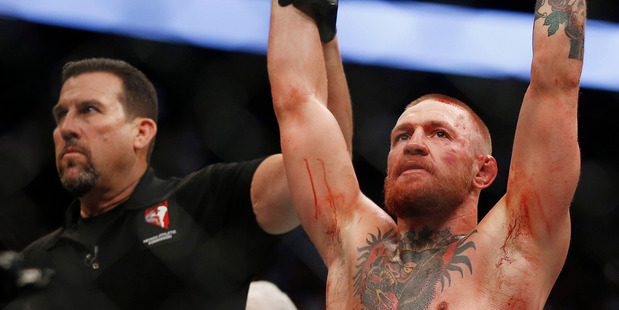 Conor McGregor reacts as he is announced the winner following his welterweight mixed martial arts bout against Nate Diaz at UFC 202. Photo / AP