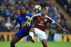 Leicester City's Wes Morgan, left and Burnley's Andre Gray battle for the ball. Photo / AP