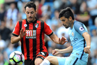 Manchester City's Nolito chips the ball away from Bournemouth defender Adam Smith. Photo / AP