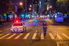 Police stand guard as the cordon Sixth Avenue near the scene of the explosion on West 23rd Street and Sixth Avenue in Manhattan's Chelsea neighborhood. Photo / AP