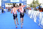Britain's Alistair Brownlee, right, helps his brother Jonny to get to the finish line during the Triathlon World Series event in Cozumel Mexico. Photo / AP.