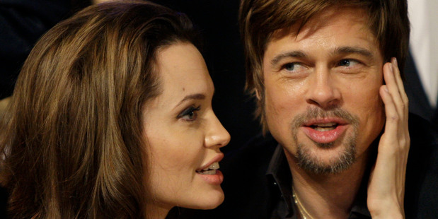 Angelina Jolie, left, and Brad Pitt sit together before the start of the 14th Annual Screen Actors Guild Awards in Los Angeles. Photo / AP