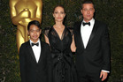 Maddox Jolie-Pitt, from left, Angelina Jolie and Brad Pitt attend the 2013 Governors Awards in Los Angeles. Photo / AP