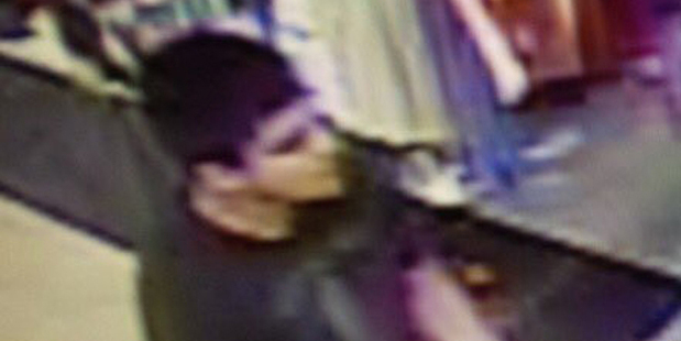 This video image shows a suspect wanted by the authorities regarding a shooting at the Cascade Mall in Burlington. Photo / AP