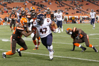 Kiwi Paul Lasike runs the ball against the Cleveland Browns during the NFL pre-season. Photo / AP