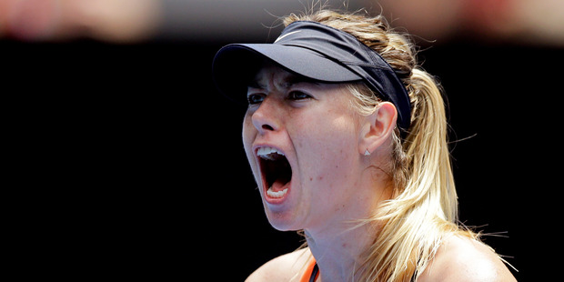 Maria Sharapova of Russia celebrates after winning a point against Serena Williams of the United States during their quarterfinal match at the Australian Open. Photo / AP.