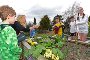 Garden co-ordinator Andrea Green offers some gardening tips at Welcome Bay Community Garden.  Photo/George Novak