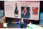 A bottle of Wairarapa Pinot Noir signed by Prime Minister John Key helped earn $25,000 for Phil Goff's mayoral campaign.