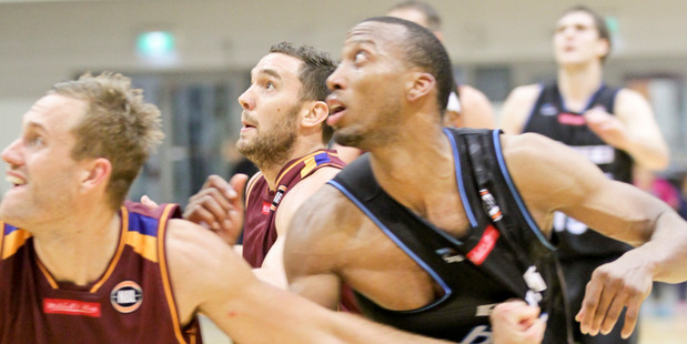 Akil Mitchell (right) getting up close and personal with Brisbane's Mitchell Young. Photo / Hawke's Bay Today