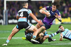 Kevin Proctor of the Storm is tackled during the round 26 NRL match between the Melbourne Storm and the Cronulla Sharks at AAMI Park on September 3, 2016 in Melbourne, Australia. PHOTO/QUINN ROONEY/GETTY IMAGES