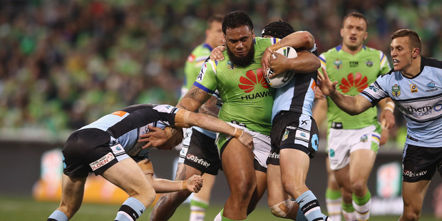 Junior Paulo of the Raiders is tackled during the NRL Qualifying Final match between the Canberra Raiders and the Cronulla Sharks. Photo / Getty Images.