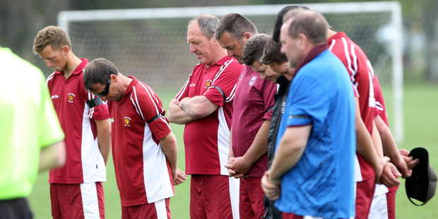 MARK OF RESPECT: Hibernian Masters players observe a minutes silence for teammate Jeff Partington who died after a match in the Marist football tournament in Napier yesterday. PHOTO/PAUL TAYLOR