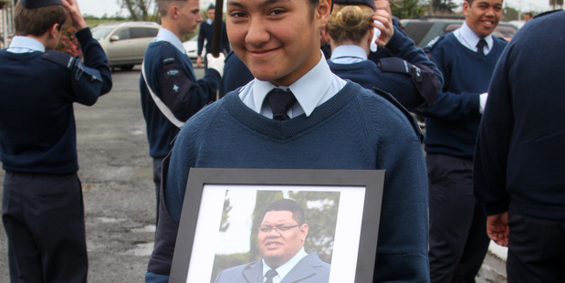 LOVING MEMORY: Leading Air Cadet Nikki Henry honouring the memory of Flying Officer Waarena (Waa) Whareaitu, who commanded Kaitaia's No 64 ATC Squadron until his untimely death last year, at Sunday's Battle of Britain commemoration at Waipapakauri.