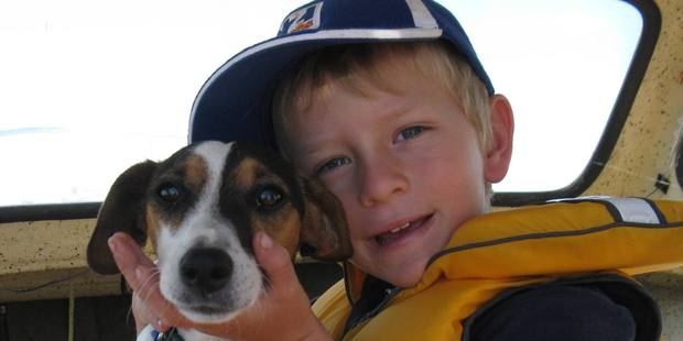 Elliott Stachurski, 9, with the family pet, Possum who has been found. Photo/supplied