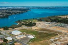 An aerial view of Hobsonville Point with most of the vacant land for sale in the foreground.