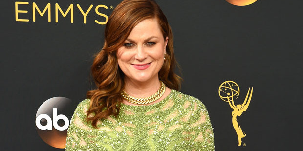 Amy Poehler chose a pea soup-coloured ensemble. Photo / Getty