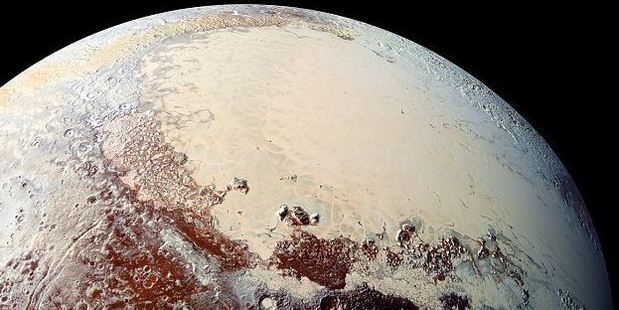 Pluto has an ever-changing climate, covered in nitrogen ice, methane frost and even a giant glacier. Photo / NASA