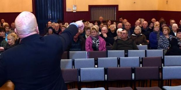 Clutha Mayor Bryan Cadogan holds the chair during a public meeting to discuss the proposal to close the ANZ Milton branch last night. Photo by Peter McIntosh.