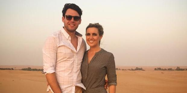 Alison, pictured on the right, with her partner, left, braving the scorching temperatures in Dubai. Photo / Supplied
