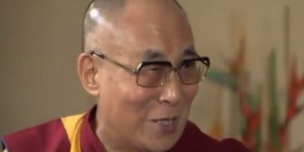 The Dalai Lama placed his hand over his head to mimic Trump's distinct coif of hair. Photo / via Twitter