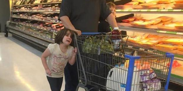 "The young girl allegedly yelled ""please stop. I promise I won't do it again. Please stop!"" as her father pulled the shopping trolley with her hair around the handle. Photo / Erika Burch / Facebook"