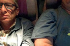 Italian lawyer Giorgio Destro (left), captured his predicament on the Emirates flight from Cape Town to Dubai by taking a selfie of his overweight seat neighbour (right) as evidence. Photo / Supplied