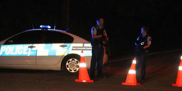 Southland police cordoned off roads after a woman was shot in Invercargill last night. Photo / Otago Daily Times
