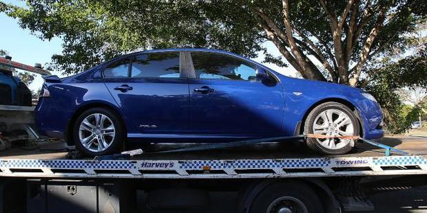 The blue Ford Falcon described by police also week as a 'vehicle of interest' in the murder investigation. Photo / Marc Robertson, News Corp Australia