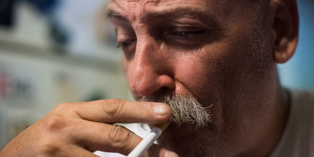 Jim Cooley smokes a cigarette as he rests after doing errands at his home in Winder, Ga. Photo / The Washington Post / Jabin Botsford