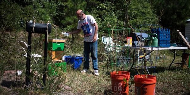 Jim Cooley feeds bees at his home in Winder, Ga. Photo / The Washington Post/ Jabin Botsford