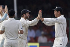 Ross Taylor, right, and Kane Williamson celebrate the dismissal of India's Ravichandran Ashwin. Photo / AP