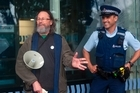 National Day of Action to leagalise cannabis. Support Glenn Grayson shares his views at the Tauranga Police Station, despite present company. Photo/Andrew Warner.
