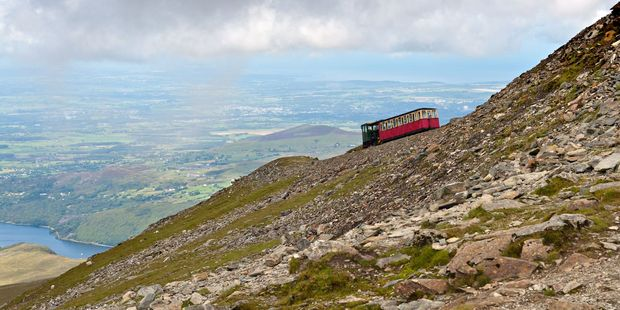 The traditional steam service takes people to Snowdon's 1085m summit. Photo / 123rf