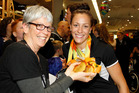 Sophie Pascoe, right, arrives at Auckland airport this morning after a successful showing the the 2016 Paralympics. Photosport