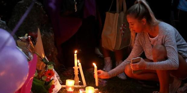 Hundreds of Marsden residents gathered for a candle light vigil at a local park to pay their respects to schoolgirl Tiahleigh Palmer. Photo / Scott Fletcher, News Corp Australia