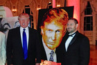 Donald Trump with the painting that he bought. Photo / Havi Schanz