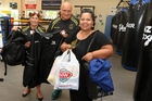 Pam (left) and Henare O'Keefe with Brenda Wainohu dropping off goods for the homeless at the Flaxmere Boxing Academy. Photo / Duncan Brown