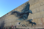 Dal East's mural of Haast's Eagle on Dunedin's Street Art Trail. Other artists include Pixel Pancho's horse and rider, Dunedin artist Jon Thom's portrait and ROA's tuatara. Image / Chris Allan