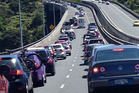 Vehicles are queued for kilometres before the Northern Gateway toll-road tunnel on State Highway 1. Photo / Chris Reed