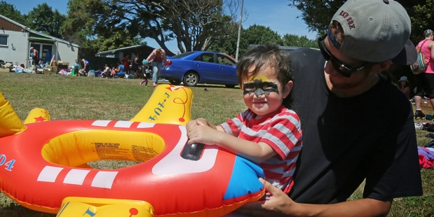 FLYING: Connor Haddon-Moana with dad Josiah Moana was happy to find this inflatable toy at the market in Duncan St yesterday. PHOTO/BEVAN CONLEY