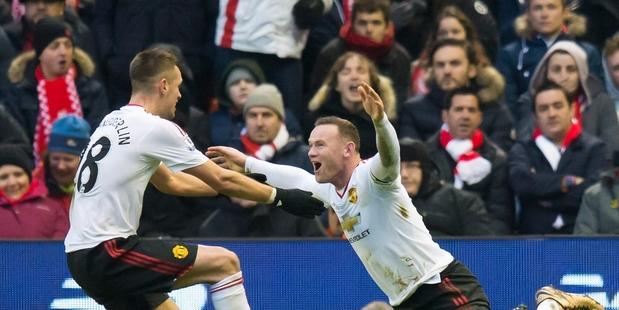 Wayne Rooney celebrates after scoring the 78th minute winner against Liverpool. Photo / AP