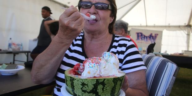 Gail Pompey enjoys cooling down with a watermelon and icecream treat at the festival.