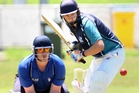 Kerikeri High First XI batsman Cameron Shepard prepares to drive, while City's wicketkeeper Ashton Pattenden looks on.