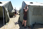 Corporal Rochelle Rowe, communications and information systems for the Royal New Zealand Air Force, sets up the tent she will sleep in for the next 12 days of the Exercise Skytrain camp at Hawke's Bay Airport. Photo / Duncan Brown