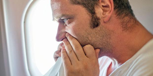 A fellow passenger's flatulence can ruin a flight. Photo / 123RF