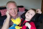 Meningitis survivor William Burton and dad Derek. Photo / Mark Mitchell