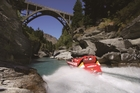 The Shotover Jet heads for Edith Cavell Bridge, just out of Queenstown. Photo / Supplied