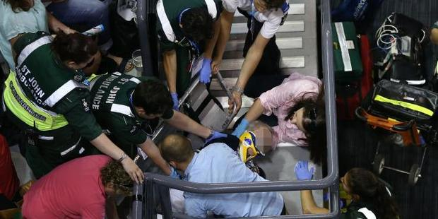 Paramedics provide attention to an injured patron at the Australian Open. Photo / Getty