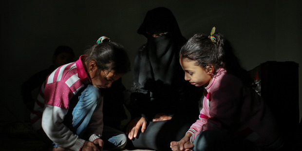 Syrian refugee children Nahlah and Nour. Their mother Isis members claim to be pious, but use fear and secret informers just as the Assad regime did. Photo / AP