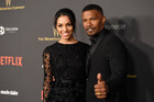 Jamie Foxx arrives at the Golden Globes after party with Corinne Foxx. Foxx reportedly saved a man from a burning car wreck. Photo/Getty